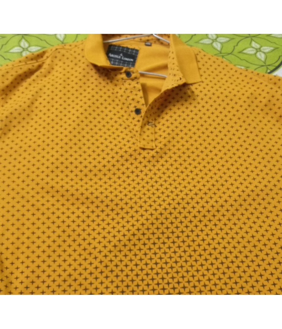 Yellow t shirt with black dots