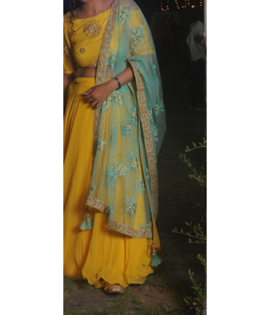 Yellow lehenga choli with light turquoise dupatta