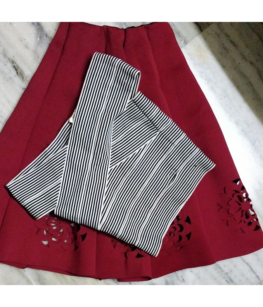 Crop top and red flared knee length skirt