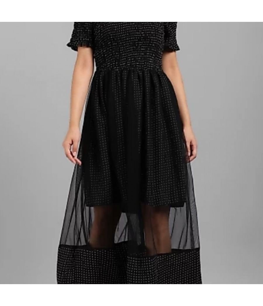 Polka dotted black dress